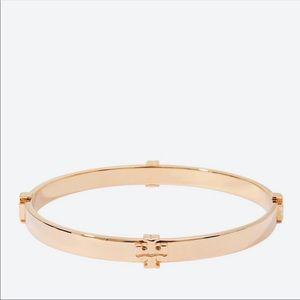 Tory Burch logo hinged bracelet in metallic rose